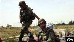 Militer Suriah mengerahkan para personilnya untuk mengamankan aksi demonstrasi di berbagai kota (11/5).