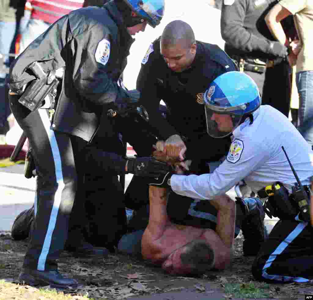 An unidentified protestor is arrested in McPherson Square in downtown Washington Sunday, Dec. 4, 2011. U.S. Park Police are arresting Occupy DC protesters who are refusing to dismantle an unfinished wooden structure erected in the park square overnight. (