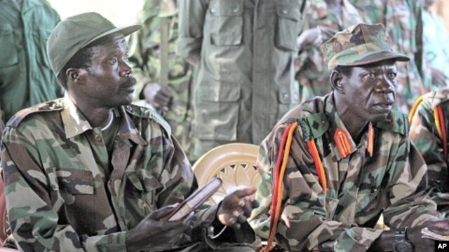 Joseph Kony, the Lord's Resistance Army (LRA) leader, left, and his deputy Vincent Otti, sit inside a tent at Ri-Kwamba in Southern Sudan. (Nov. 2006 file photo)