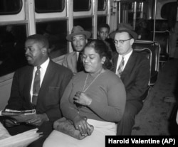 wo black ministers were among the first to ride after the Supreme Court's integration order went into effect, Dec. 21, 1956. At left, front seat, is the Rev. Ralph Abernathy, while at left in the second seat is the Rev. Dr. Martin Luther King Jr