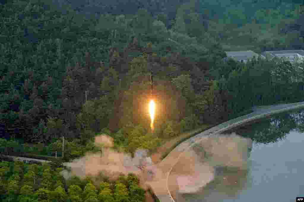 This undated photo released by North Korea's official Korean Central News Agency (KCNA) shows a test-fire of a ballistic missile at an undisclosed location in North Korea.