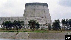 Reactor No. 4 of the Chernobyl nuclear power plant stands encased in lead and concrete following the Reactor No. 4 of the Chernobyl nuclear power plant stands encased in lead and concrete following the April 1986 accident, which released a cloud of radiat