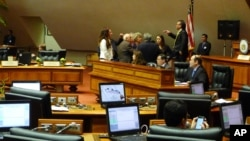 Republican and Democratic leaders in the Hawaii House discussed how to proceed with a vote to remove Rep. Beth Fukumoto from her post as minority leader, Feb. 1, 2017, in Honolulu.