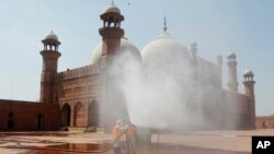 Volunteers disinfects the historical Badshahi Mosque ahead of the Muslim fasting month of Ramadan, in Lahore, Pakistan, April 22, 2020.