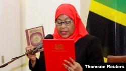 FILE PHOTO: Tanzania's new President Samia Suluhu Hassan takes oath of office following the death of her predecessor John Pombe Magufuli in Dar es Salaam