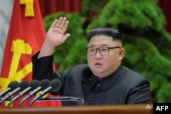 FILE - This picture released by North Korea's official Korean Central News Agency, Jan. 1, 2020, shows North Korean leader Kim Jong Un attending a session of the 5th Plenary Meeting of the 7th Central Committee of the Workers' Party of Korea in Pyongyang.