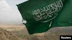 In this file photo, Saudi Arabia's national flag is seen at the Khoba frontline border with Yemen, January 27, 2010.