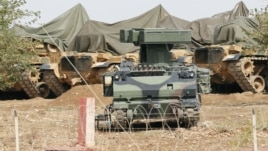 A mobile missile launcher is positioned at a military base on the Turkish-Syrian border at Suruc in Sanliurfa province, October 6, 2012.
