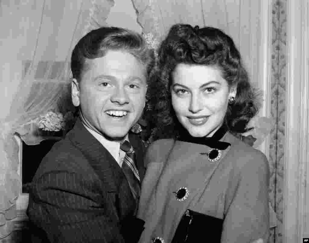 Mickey Rooney, 21, Movieland's No. 1 box office star, and Ava Gardner, 19, of Wilson, N.C., pose together shortly after the couple applied for a marriage license, in Santa Barbara, California, Jan. 5, 1942.