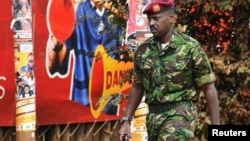 FILE - Muhoozi Kainerugaba, a son of Uganda's President Yoweri Museveni, has been promoted to the rank of major general, prompting speculation about possible future succession. He's shown in 2010.