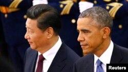 Tổng thống Mỹ Barack Obama và Chủ tịch Trung Quốc Tập Cận Bình tại Bắc Kinh, ngày 12/11/2014. Chính quyền Obama đã cảnh báo Trung Quốc về sự hiện diện của các nhân viên thi hành công lực của nước này ở Hoa Kỳ bí mật làm áp lực buộc những người nổi tiếng đang sống lưu vong phải trở về nước.