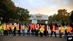 "Protesters gather in front of the White House in Washington, Nov. 8, 2018, as part of a nationwide ""Protect Mueller"" campaign."