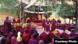 FILE - Monks gather at the Kirti monastery. Losang Thubten, a young monk who recently was detained by police, is said to be a member of Kirti monastery, whose monks have long protested regulations imposed on Tibetan monasteries by Chinese officials.