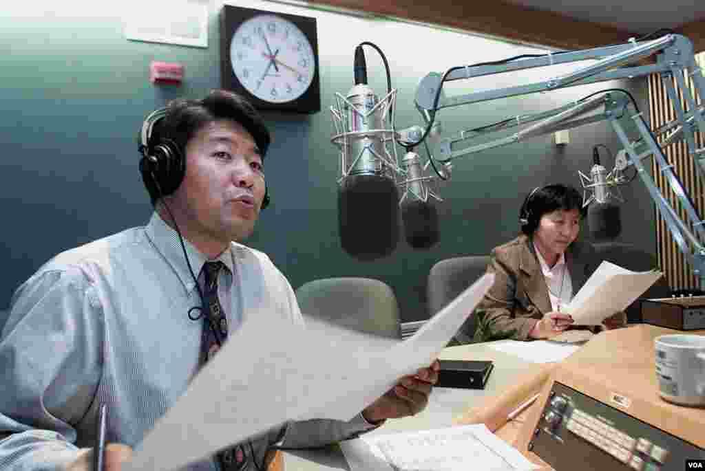 Staffers Tenzin Lhundup (left) and Tseten Chodon present the Tibetan Service's daily newscast