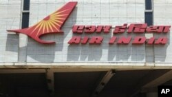 Pedestrians walk past India's flagship carrier Air India's headquarters in Mumbai on May 6, 2011.