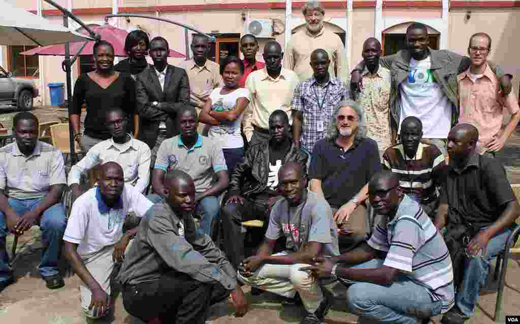 Simon Kasmiro (front row, left) joins his South Sudanese and U.S. colleagues for a group photo after a week-long training session in Juba in June 2013.