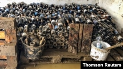 Wine bottles are pictured at the flood-affected Sermann vineyard in Altenahr, Germany, July 23, 2021.