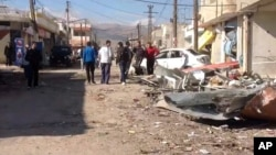 In this photo released by the Syrian official news agency SANA, a damaged area is seen after a car bomb explosion in Qatana, southwest of Damascus, Syria, Dec. 13, 2012.