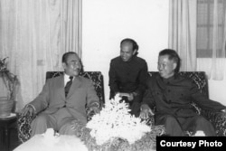 Suong Sikoeun, middle, a former high-ranking Khmer Rouge diplomat, served as interpreter during a meeting between Khieu Samphan, right, and Prince Souphanouvong, president of Laos, in the mid-1970s. (Photo provided by Suong Sikoeun)