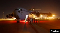 A U.S. Air Force plane carrying two Sudanese detainees released from the Guantanomo facility from Guantanamo in Cuba, arrives at Khartoum Airport early Dec. 19, 2013.
