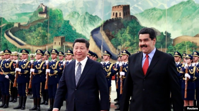 Venezuelan President Nicolas Maduro, right, walks with China's President Xi Jinping during welcome ceremony, Great Hall of the People, Beijing, Jan. 7, 2015.