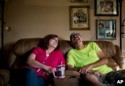 """Jeff McCoy, right, a recovering opioid addict, laughs with his wife JoAnne at their home in Dickson, Tennessee, June 7, 2017. Now, he says his wife is his addiction. """"She's my everything, she's my drug."""""""