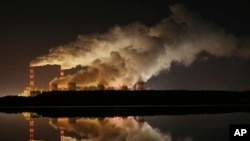 FILE - Plumes of smoke rise from Europe's largest lignite power plant in Belchatow, central Poland, Nov. 28, 2018.