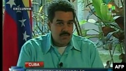 Television image shows Venezuelan Foreign Minister and Vice President Nicolas Maduro during an interview in Havana, Jan. 1, 2013.