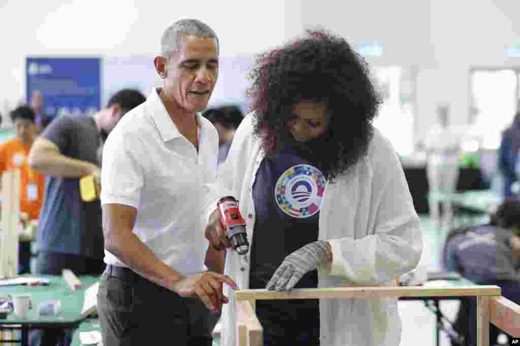 Former U.S. President Barack Obama and former first lady Michelle participate in a community services event during the sidelines of the Obama Foundation in Kuala Lumpur, Malaysia.
