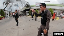 Security forces are seen at the site of a bomb attack at a supermarket in the city of Pattani, Thailand May 9, 2017.