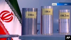 FILE - In this June 6, 2018, frame grab from Islamic Republic Iran Broadcasting, IRIB, state-run TV, three versions of domestically-built centrifuges are shown in a live TV program, from Natanz, an Iranian uranium enrichment plant, in Iran.
