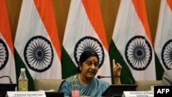 FILE - Indian Foreign Affairs Minister Sushma Swaraj gestures during a press conference in New Delhi.