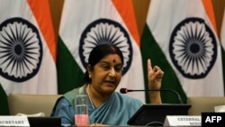 FILE - Indian Foreign Affairs Minister Sushma Swaraj gestures during a press conference in New Delhi on Aug. 22, 2015.