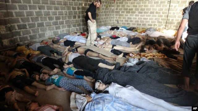 A photograph taken on August 22 purports to show some of the estimated 1,000 victims of a suspected chemical weapons attack in the Damascus suburb of East Ghouta, the day after a missile attacked by government forces. The government denies chemical weapons wer