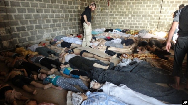 A photo taken on August 22 purports to show some of the estimated 1,000 victims of a suspected chemical weapons attack in the Damascus suburb of East Ghouta.
