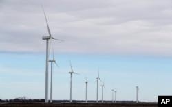 Wind turbines stand in a field, near Northwood, Iowa, Feb. 2, 2018.