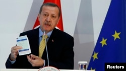 Turkey's Prime Minister Tayyip Erdogan addresses the audience during the Turkey-EU Readmission Agreement Signing Ceremony in Ankara, Dec. 16, 2013.