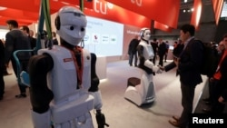 REUTERS Robots greeting visitors at Mobile World Congress