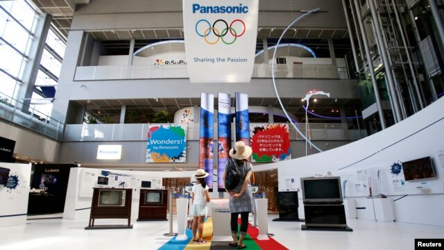 Visitors look at an exhibition showing the history of the partnership between Panasonic Corp. and Olympics at Panasonic center in Tokyo, Aug. 6, 2014.