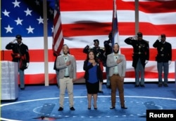 FILE - Newly naturalized U.S. citizens lead the U.S. Pledge of Allegiance at the start of the final day of the Democratic National Convention in Philadelphia, Pennsylvania, July 28, 2016.