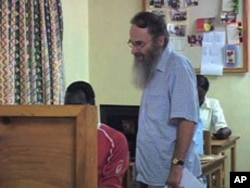 Reverend Chris Jenkins, education coordinator for the Jesuit Refugee Service's Kakuma Camp education program, works with a student, Aug 2010