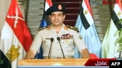 Egyptian Defense Minister Abdelfatah al-Sissi delivering a statement on July 3, 2013 as the army unveils a roadmap for Egypt's political future. (Egyptian TV photo)
