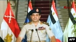 FILE - Egyptian army chief Abdel Fattah el-Sissi delivers a statement after the army toppled Egypt's first freely elected civilian president, July 3, 2013.
