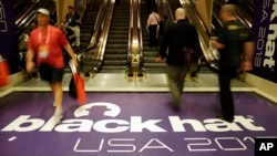 Hackers and security personal attend the Black Hat hacker conference on July 31, 2013, in Las Vegas.