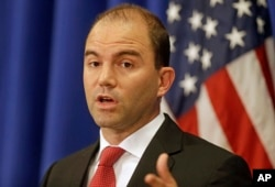 FILE - White House Deputy National Security advisor Ben Rhodes speaks to reporters during a press briefing in Edgartown, Massachusetts, Aug. 22, 2014.