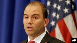 FILE - White House Deputy National Security adviser Ben Rhodes speaks to reporters during a press briefing, in Edgartown, Mass., Aug. 22, 2014.