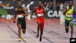 Tyson Gay, left, is on his way to win the men's 100-meter men's ahead of Richard Thompson, center, from Trinidad and Tobago, and Norway's Jaysuma Saidy-Ndure during the Athletics Montreuil meeting at the Jean Delbert stadium, in Montreuil, east of Paris,