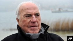 FILE - Former German chancellor Helmut Kohl on the shore of Lake Tegernsee in Bad Wiessee, southern Germany, April 5, 2013.