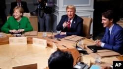 Ангела Меркель, Дональд Трамп и Джастин Трюдо на саммите G7