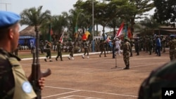 FILE - United Nations peace keeping troops take part in a ceremony in the capital city of Bangui, Central African Republic, Monday, Sept. 15, 2014.